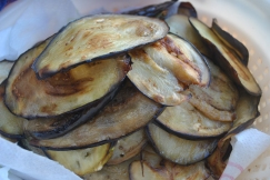 25. The fried slices being drained of excess oil
